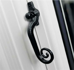 Monkey tail window handle on UPVC frame